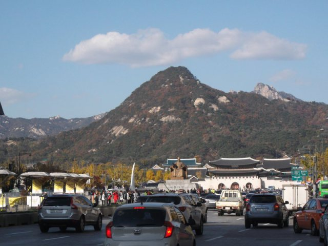 On Sejong Road, looking at Gwanghwa Gate and Bukaksan looming behind it.